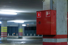 Modern Fire Shield With A Fire Extinguisher On The Parking Wall