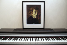 11.28.2018, Moscow, Russia. Fryderyk Chopin - Photocopy Of Portrait Painted By Ferdinand Victor Eugène Delacroix In 1838 And Piano Keyboard.