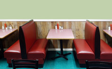 Classic Diner Interior With Red Leather Booths, Pink Tables And Blank Green Wall With Copy Space.