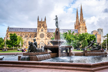 Hyde Park Fountain With St Mary's Cathedral In Background In Sydney Australia