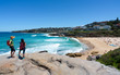 Unrecognizable people enjoying the view of Tamarama beach during coastal walk from Tamarama point in Sydney Australia