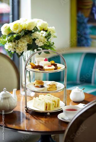 Fototapeta Delicious English afternoon tea set on a white background obraz