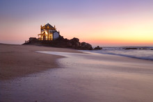 Landscape Over The Beach Of Miramar With View To Chapel Of Senhor Da Pedra At Blue Hour