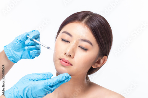 Stampa su Tela Young asian woman is getting collagen injection into her face