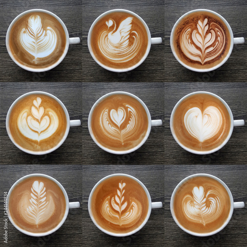 Fotografiet Collection of top view of latte art coffee mugs on timber background