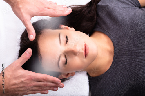 Therapist Giving Reiki Healing Treatment To Woman Canvas Print