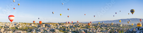 Poster Ballon Colorful hot air balloons flying over rock landscape at Cappadocia Turkey