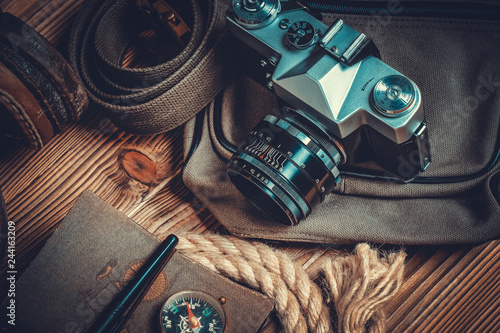 Fototapeta traveler or adventurer accessories on wood background