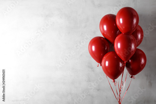 Balloons on concreat wall background