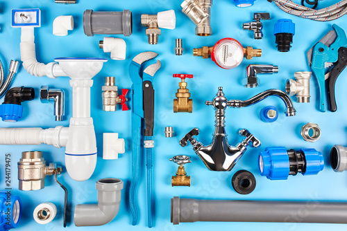 Fotomural plumbing tools and equipment on blue background top view.