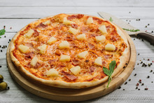 Tasty Hawaiian Pizza With Tomato Sauce And Pineapple On The White Wooden Background