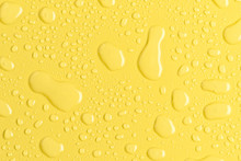 Bright Water Droplets On Yellow Synthetic Material Surface