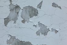 Peeling White Paint On A Gray Concrete Wall