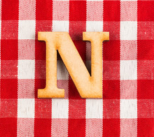 Letter N Of The Alphabet - Texture Of A Red And White Checkered Picnic Blanket