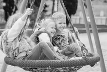 Three Children Playing In The Park