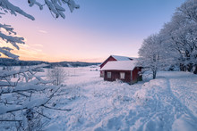 Abandoned House With Snowy Landscape And Sunset At Winter Evening In Finland