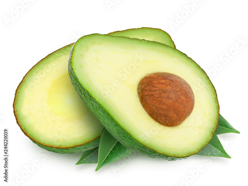 Two slices of avocado with leaves isolated on the white background. One slice with core. Design element for product label.