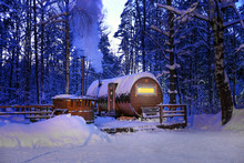 Round Wooden Bath In The Winter Snowy Forest At Night