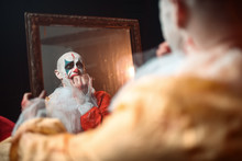 Frightened Bloody Clown Looking At The Mirror