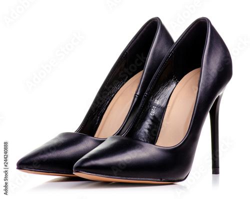 Female black leather high heels shoes on white background isolation Fototapete
