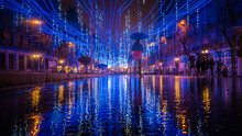 Calle De Alcala Street Downtown Madrid With Christmas Decorations Reflected On The Floor On A Rainy Day In January During Spanish Winter