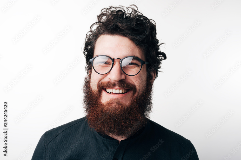 Fototapety, obrazy: Portrait of beautiful mature bearded guy in dark blue shirt with stylish hair smiling and looking in camera