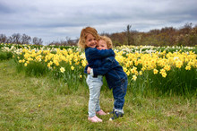 Twins In Daffodil Field