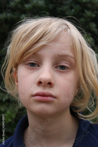 Fotografie, Obraz  Portrait of a pale unhappy tired listless young blond girl