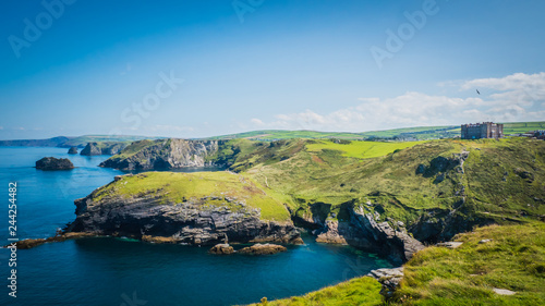 Merlin's Cave, green rocky cliffs, dramatic landscape with Atlantic Ocean / Celtic Sea view from Tintagel castle island in Cornwall, United Kingdom, UK Canvas Print