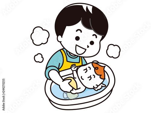 赤ちゃんを沐浴させるお父さん Fototapet