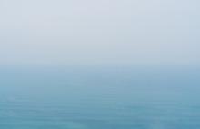 Blue Sea With Mist And Overcast Sky, Mystery Environment Over Ocean
