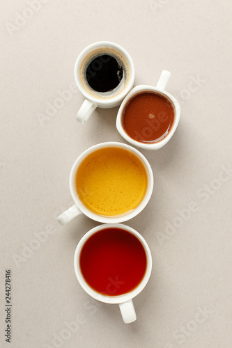 Fotografie, Obraz  Many white cups with different hot beverage - espresso coffee, cocoa, black and green tea