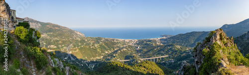 Fotografie, Obraz  Panoramic view of Menton and the surrounding hillside buildings in front of the