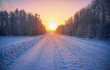 Sun Over Siberian Rural Empty Road Under The Snow At Morning Time