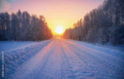 Sun over siberian rural empty road under the snow at morning time Fototapet