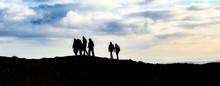 Group Of Hikers On The Ridgeway Trail Across Barbury Castle, Swindon, Wiltshire, UK