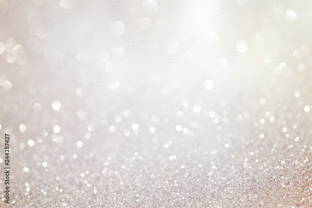 Fototapety, obrazy: Silver glittering christmas lights. Blurred abstract background