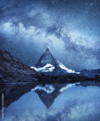 In de dag Nachtblauw Matterhorn and reflection on the water surface at the night time. Milky way above Matterhorn, Switzerland. Beautiful natural landscape in the Switzerland