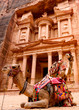 Leinwanddruck Bild Spectacular view of two beautiful camels in front of Al Khazneh (The Treasury) at Petra. Petra is a historical and archaeological city in southern Jordan.