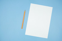 A Sheet Of White Paper With An...