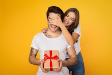Girl Covering Boyfriend Eyes And Giving Him Present