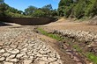 canvas print picture - Drought concept image consisting of a dry dam in South Africa.
