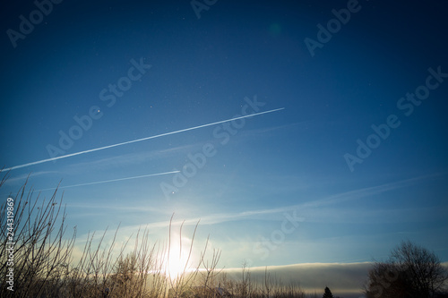 Photo  Aircraft trails on blue sky at winter