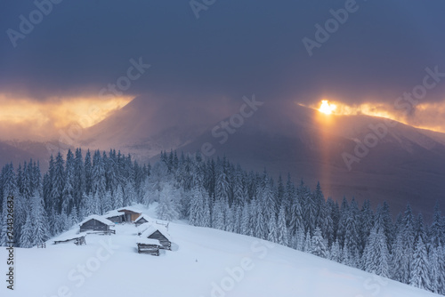 Foto op Plexiglas Winter, active holidays in the Carpathian Mountains with picturesque huts and plenty of snow.