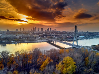 Fototapeta Miasta Beautiful panoramic aerial dsron view to Swietokrzyski Bridge (Polish: most Świętokrzyski, English: Holy Cross Bridge) - is a bridge over the Vistula river in Warsaw, Poland, from dron DJI Mavic Air
