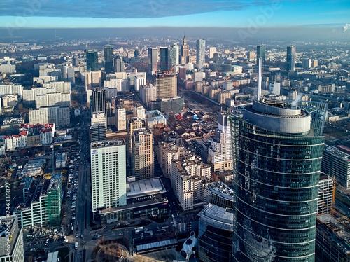 Fototapeta WARSAW, POLAND - NOVEMBER 27, 2018: Beautiful panoramic aerial drone view to the center of Warsaw City and The Warsaw Spire - 220 metre neomodern office building on European square (Plac Europejski) obraz