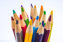 Colored Pencils Arranged In A Group On White Background