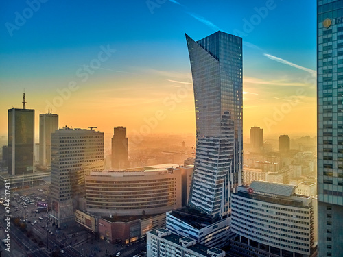 "WARSAW, POLAND - DECEMBER 01, 2018: Beautiful panoramic aerial drone view to the center of Warsaw City and ""Zlota 44"", residential skyscraper Zlote Tarasy (Golden Terraces) - commercial modern complex"