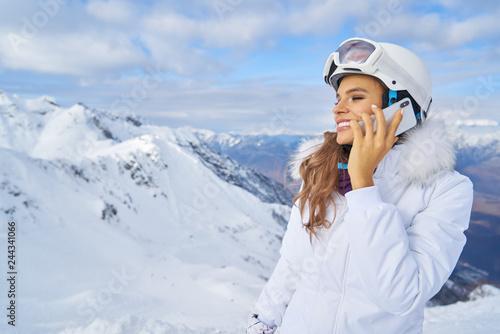Fotografie, Obraz  Woman talk by phone on mounting ski resort