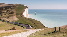 Beachy Head And The English Channel. A Footpath Leading Into A View Of The South Coast Of England Towards Beachy Head Cliff And Its Lighthouse.